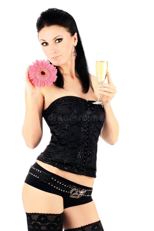 Brunette bonito com um vidro do champanhe foto de stock royalty free