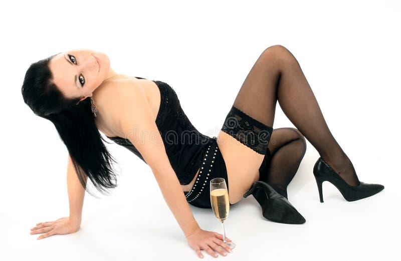 Brunette bonito com um vidro do champanhe imagem de stock royalty free