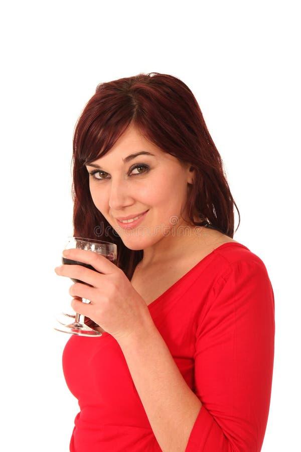 Brunette bonito com vidro de vinho fotografia de stock
