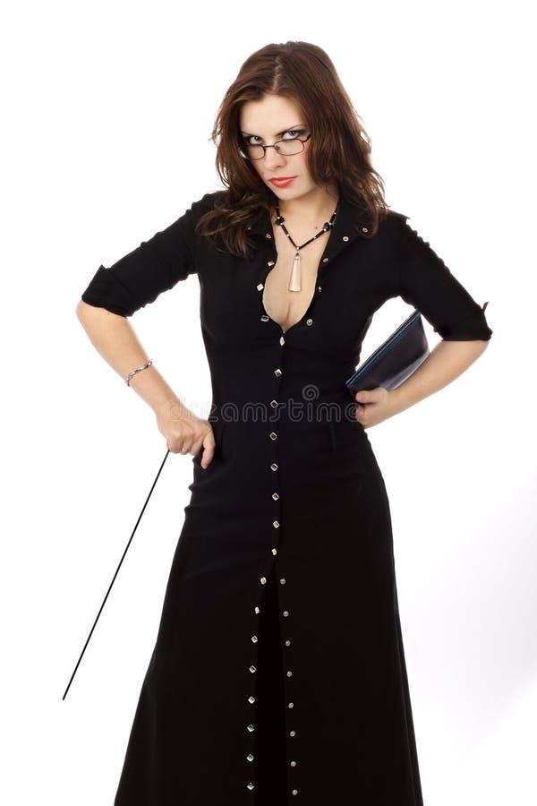 Brunette bonito em um vestido preto fotos de stock