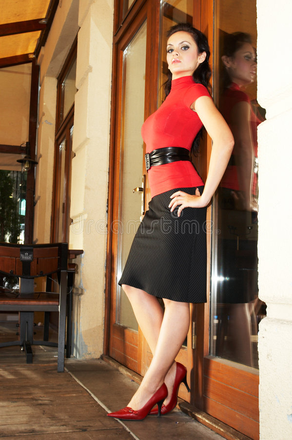 Brunette business woman in red bluse royalty free stock photos