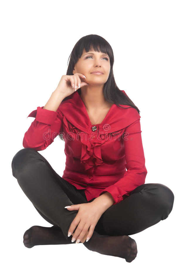 Brunette Caucasian Woman Sitting on Floor royalty free stock photo