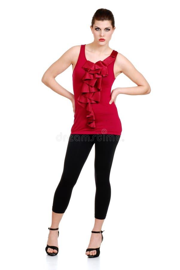 Brunette che porta i pantaloni neri ed agrostide bianco fotografia stock libera da diritti