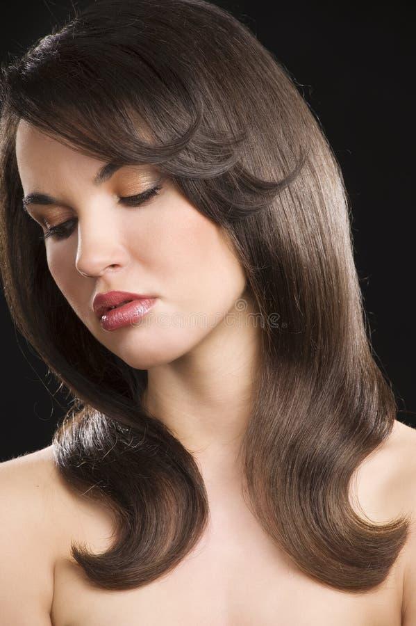 Brunette com penteado fotografia de stock