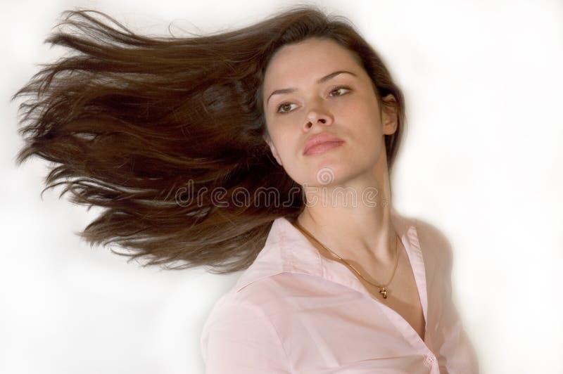 Brunette con el pelo que agita imagen de archivo libre de regalías