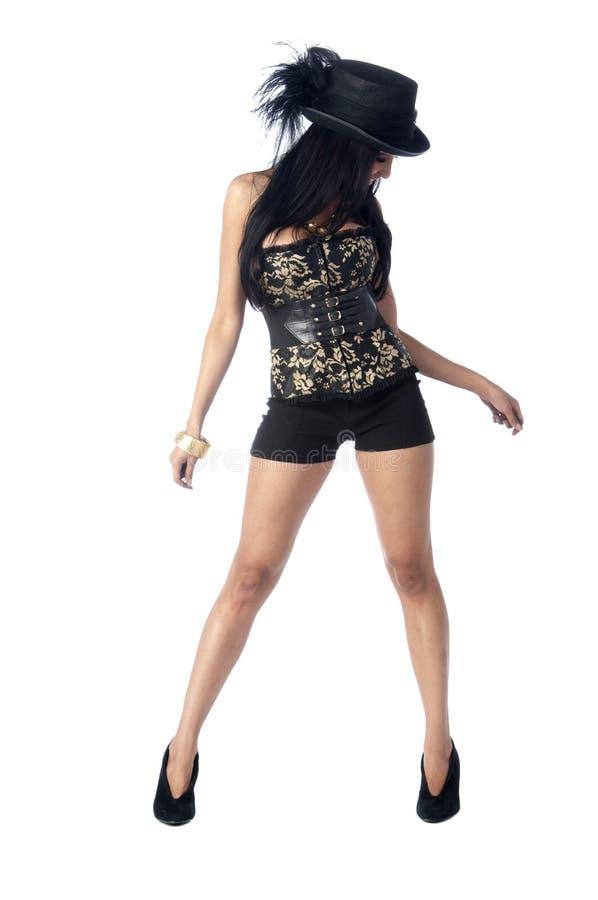 Brunette in corsetto e cappello superiore fotografie stock libere da diritti