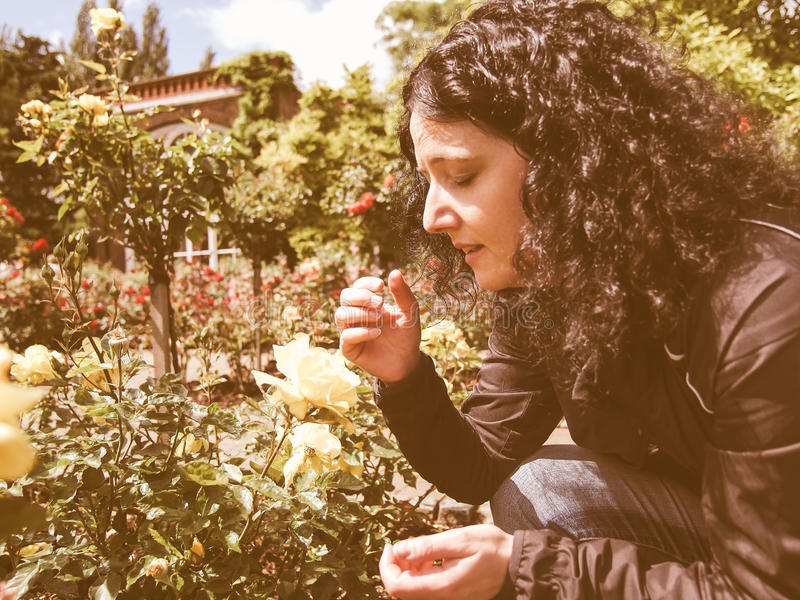 Brunette coughing vintage. Pretty young brunette girl sneezing and coughing as a result of allergy to pollen airborne particles in spring vintage royalty free stock photography