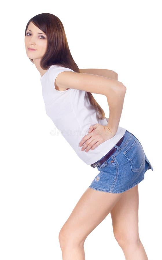 Brunette in denim skirt. Lovely brunette in denim skirt royalty free stock image