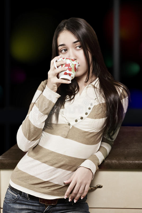 Brunette drinking royalty free stock image