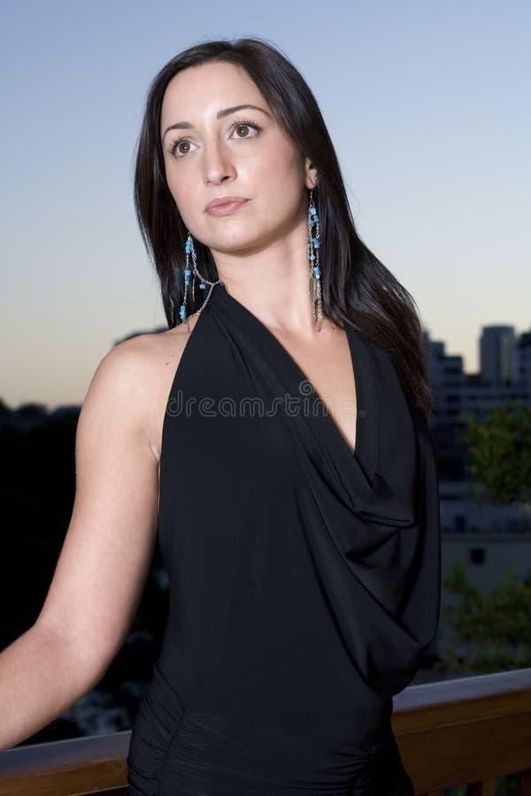 Brunette at dusk stock photos