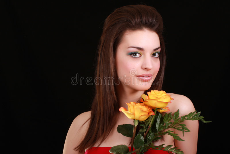 Brunette e flores imagem de stock royalty free