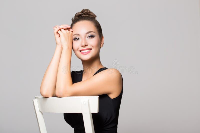 Brunette in elegant makeup stock images