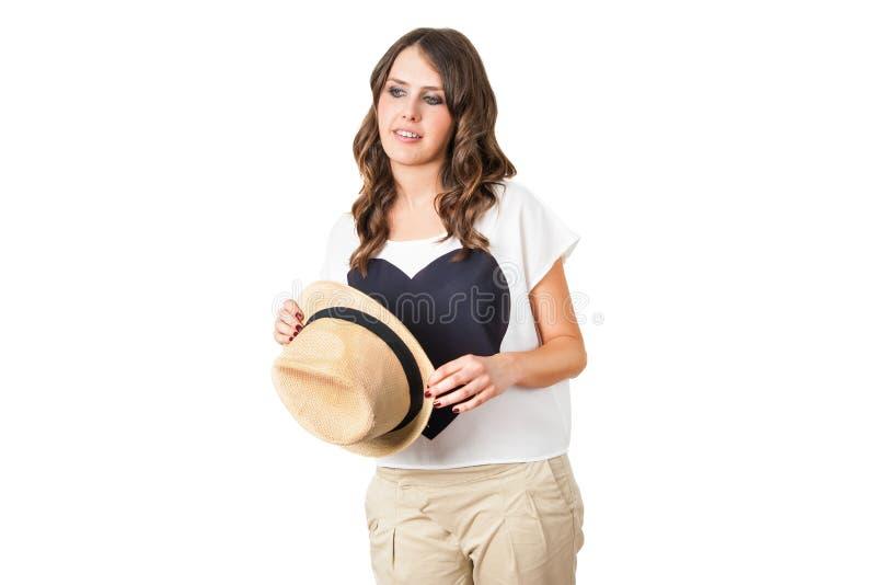 Brunette elegante novo com um chapéu à moda fotos de stock royalty free