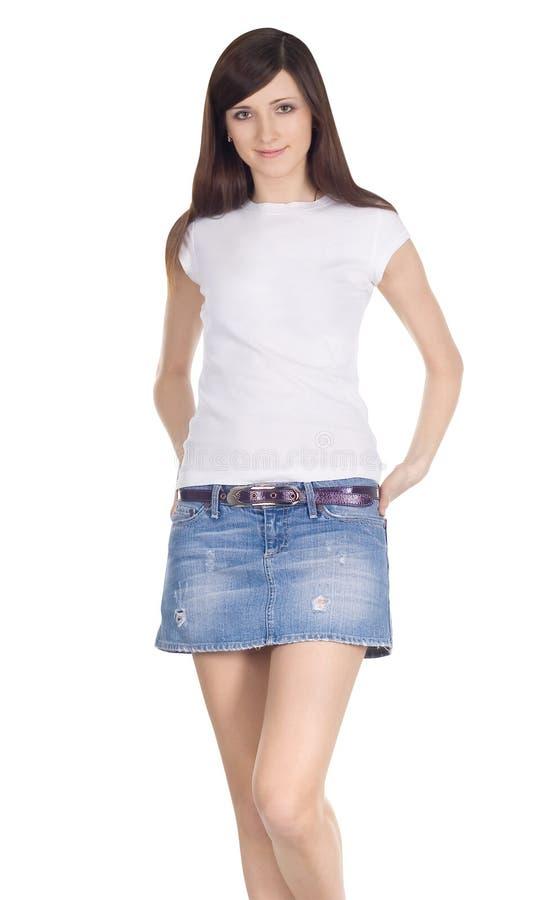 Brunette en falda del dril de algodón foto de archivo