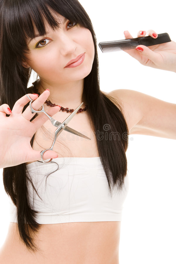Brunette encantador com tesouras fotografia de stock royalty free