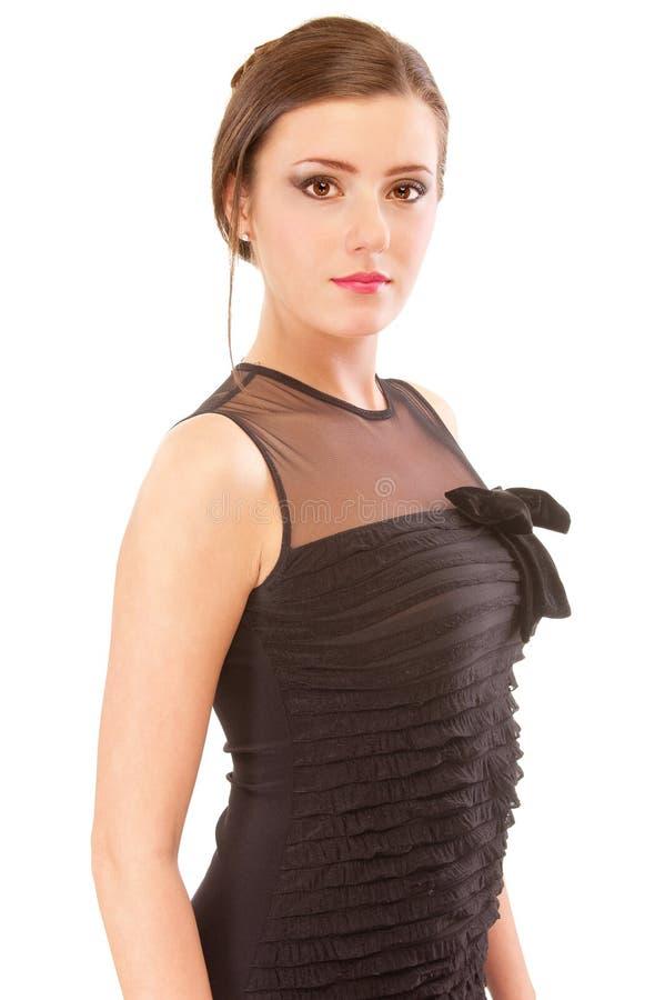 Brunette encantador en vestido de noche negro foto de archivo libre de regalías