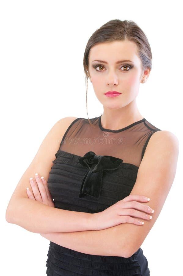 Brunette encantador en vestido de noche negro imagen de archivo libre de regalías