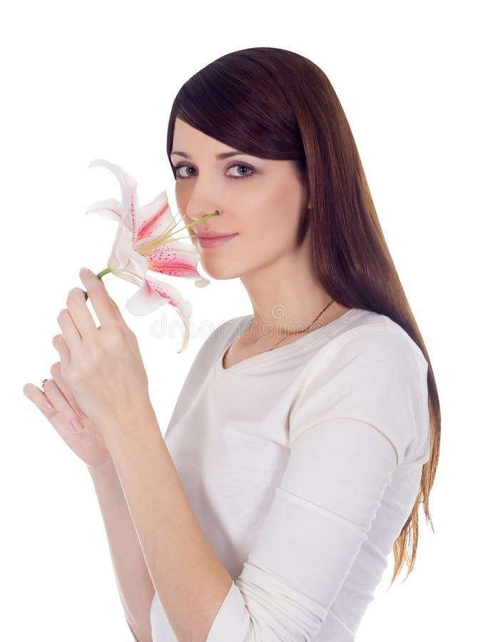 Brunette encantador novo com flor imagens de stock royalty free