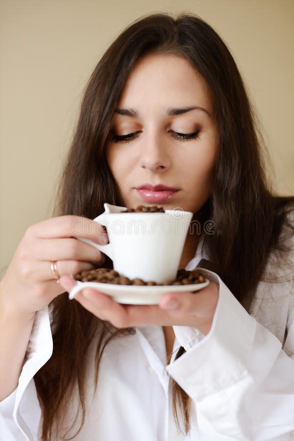 Download Brunette Enjoying Smell Of Coffee Stock Photo - Image: 28531920