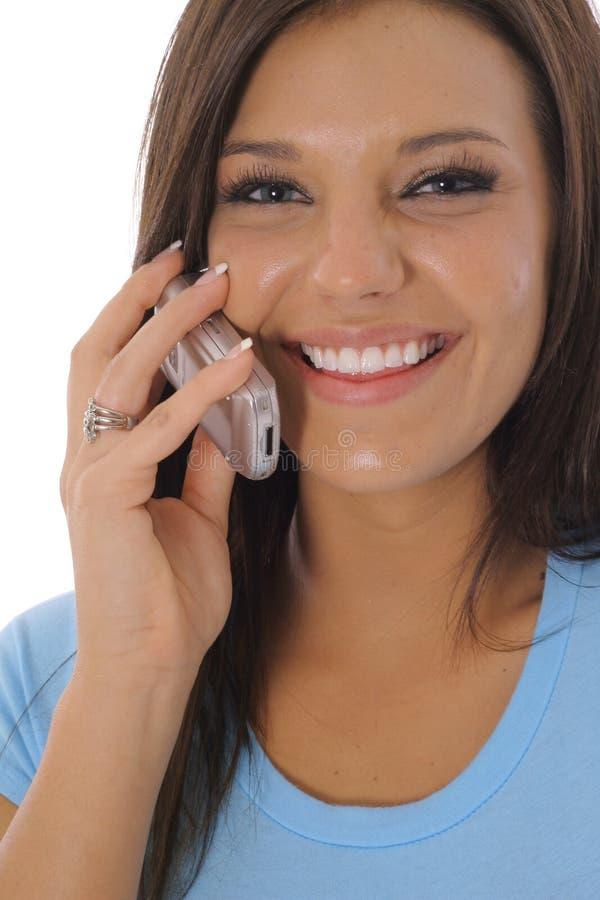 Brunette felice sul telefono immagine stock libera da diritti