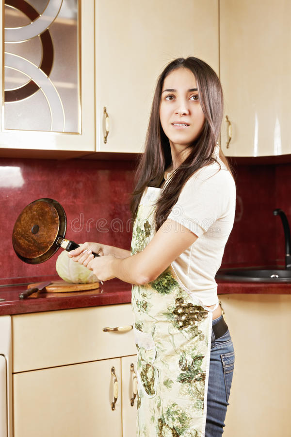 Brunette with frying pan royalty free stock photo