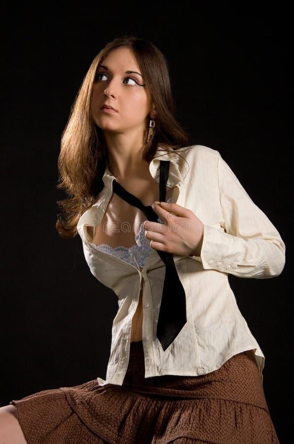 The brunette girl stock photo