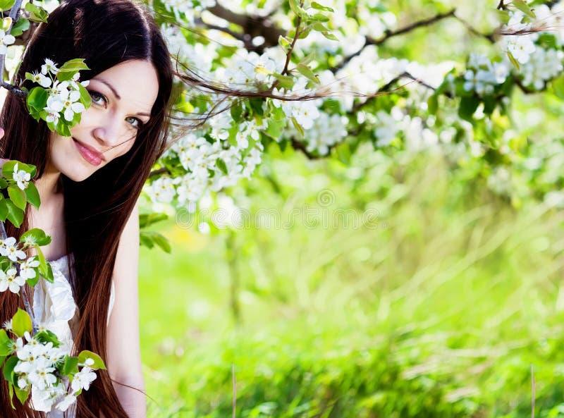 Download Brunette Girl In Blossom Garden Stock Image - Image of outdoors, long: 24500027
