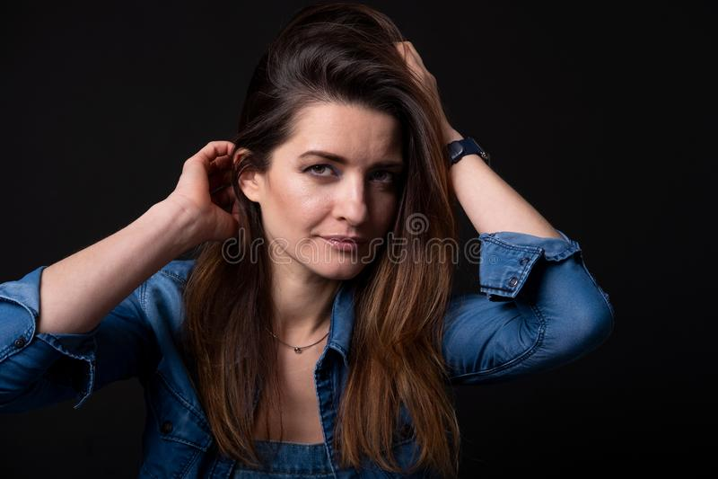 Brunette girl in blue denim jacket close up royalty free stock photography