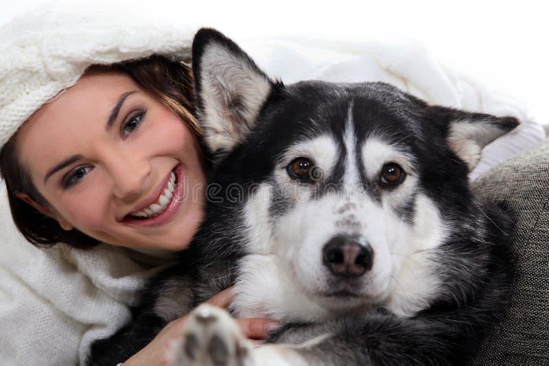 Brunette girl with dog stock photo