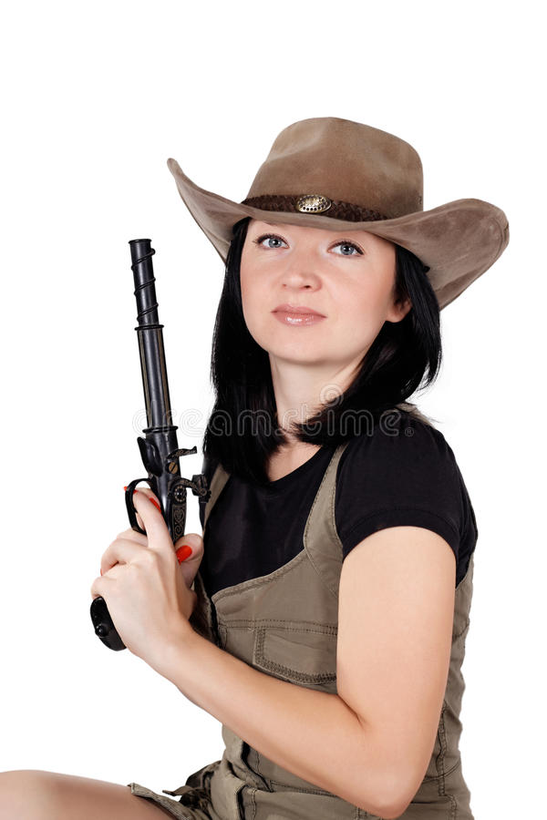 Brunette Girl In A Hat With A Gun Royalty Free Stock Photos