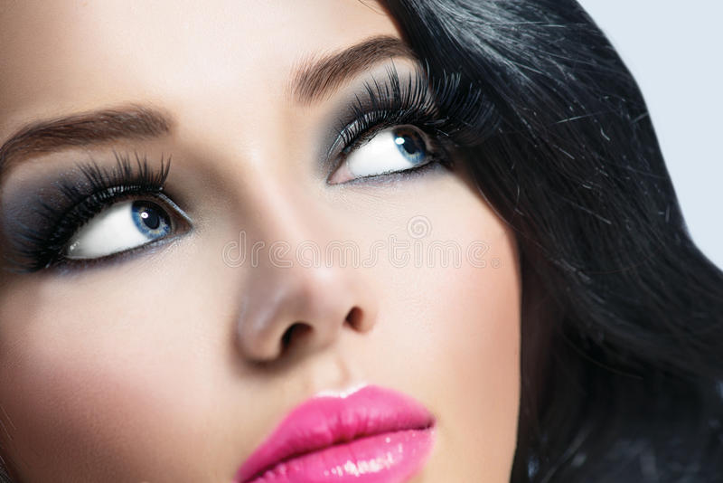 Brunette girl with healthy black hair. And perfect makeup stock photo