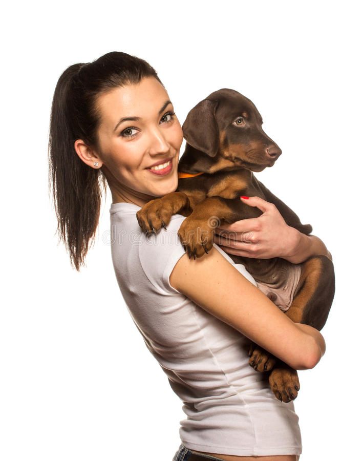 Brunette girl with her puppy isolated on white background royalty free stock photo