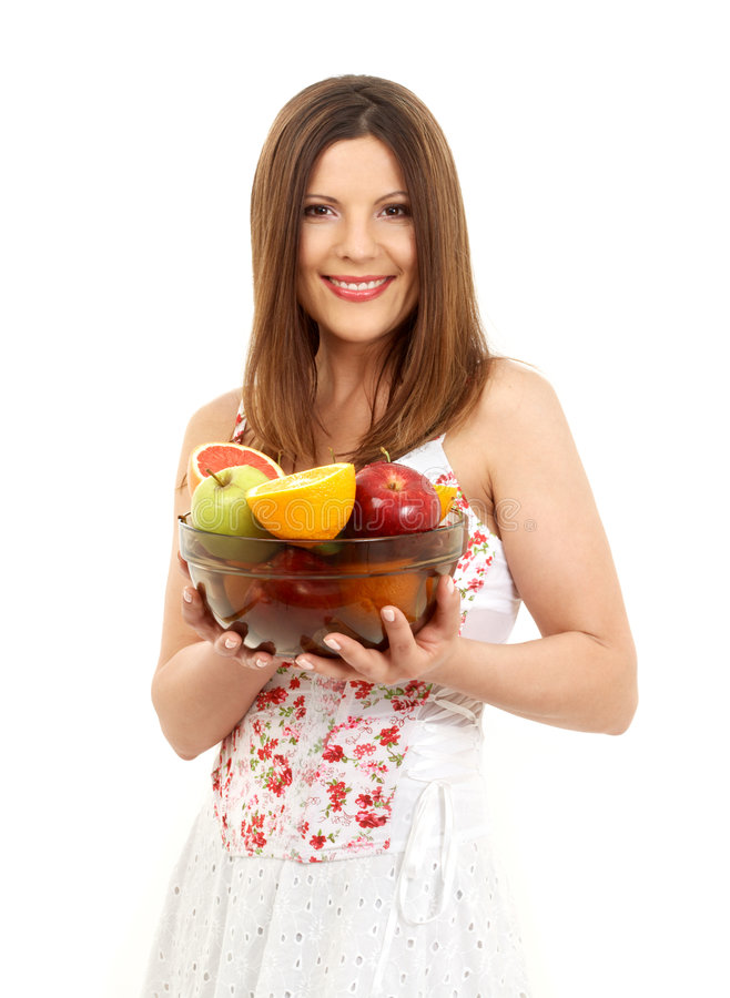 Brunette girl holding cup of f. Beautiful brunette girl holding cup of fruits over white stock photos