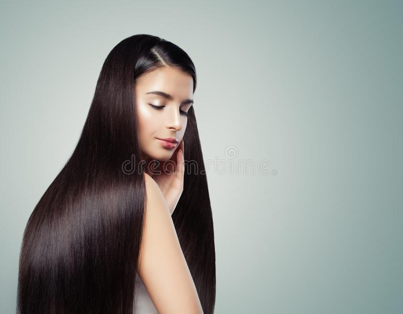 Brunette girl with long dark brown straight hair, haircare concept royalty free stock photos