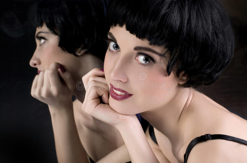 Brunette Girl Before A Mirror Royalty Free Stock Photo