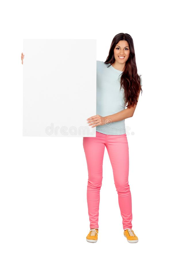 Brunette girl with pink pants holding a blank poster. Isolated on a white background royalty free stock images