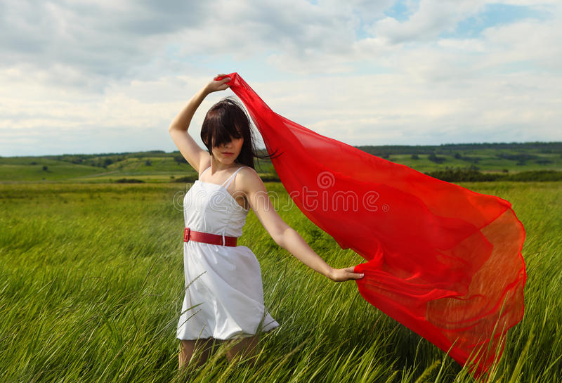Brunette Girl With Red Fabric In Summer Day Royalty Free Stock Image
