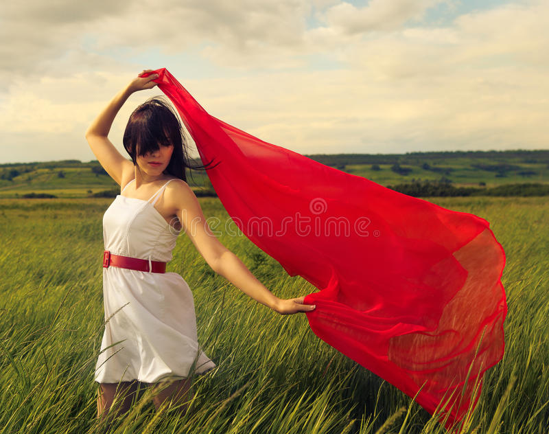Download Brunette Girl With Red Fabric In Summer Day Stock Image - Image: 25217071