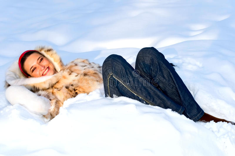 Brunette girl in snow royalty free stock photo