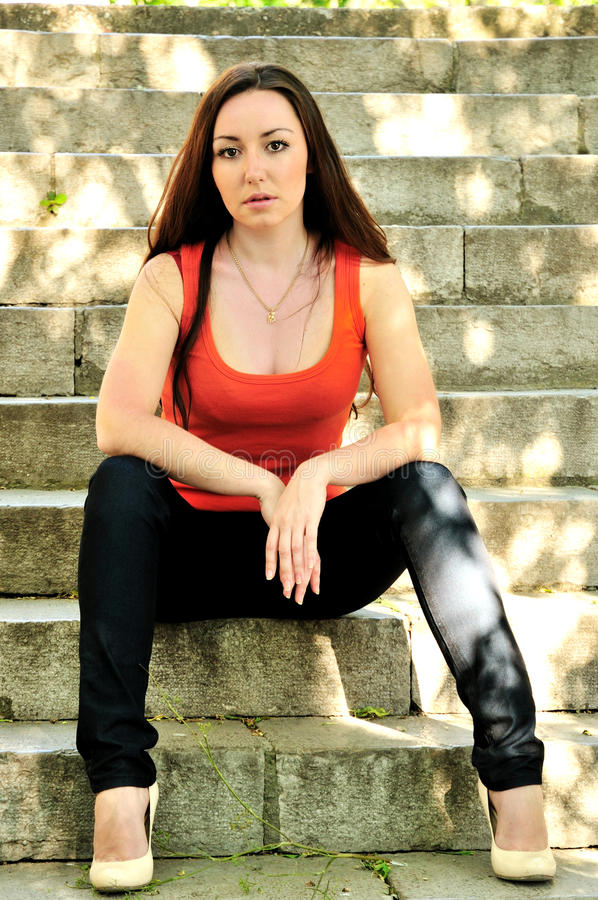 Download Brunette Girl On The Stairs Stock Photo - Image: 12928226