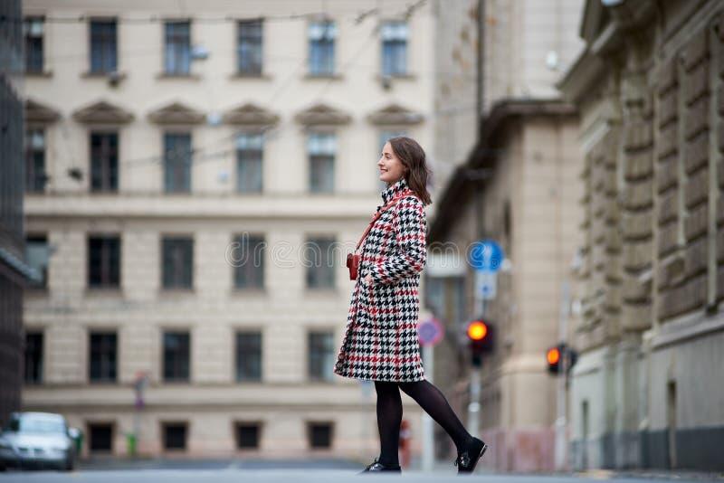 Brunette girl is walking down the street in Budapest stock images