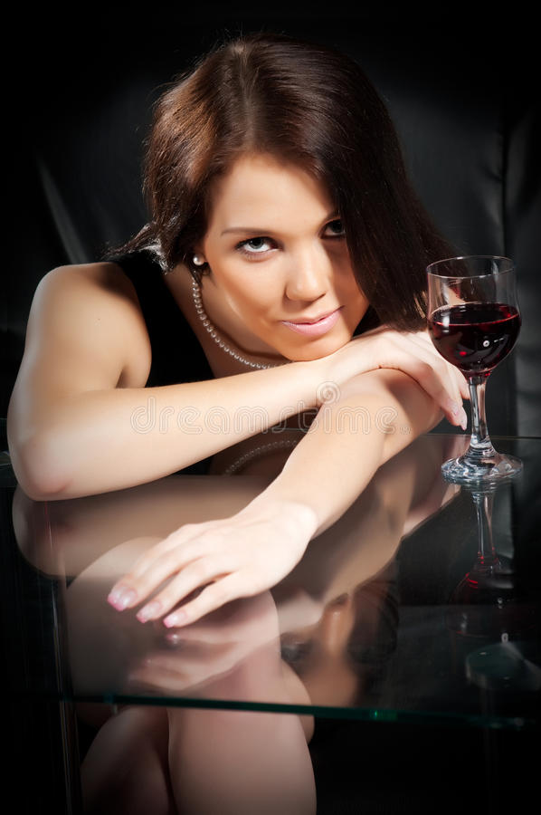 Brunette With A Glass Of Wine Stock Photo