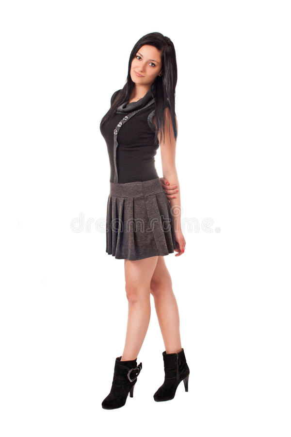 Brunette grazioso isolato in vestito nero fotografia stock