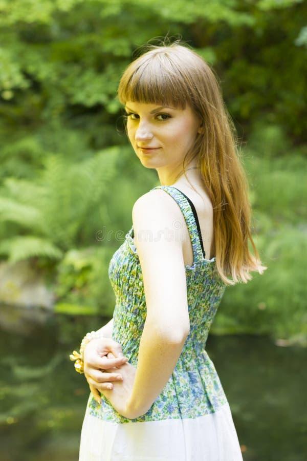 Brunette_in_green-white_dress_20 imagem de stock
