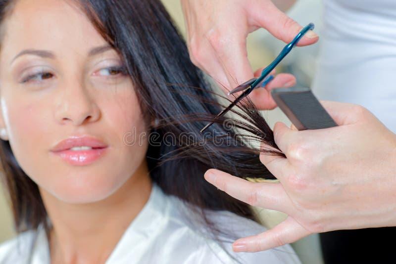Brunette having hair restyled stock photos