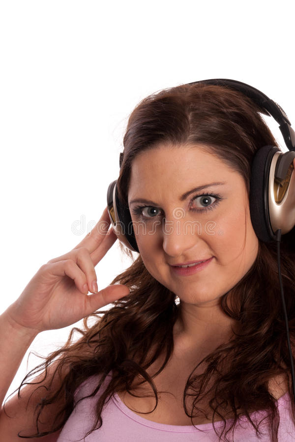 Brunette in headphones listening music royalty free stock images