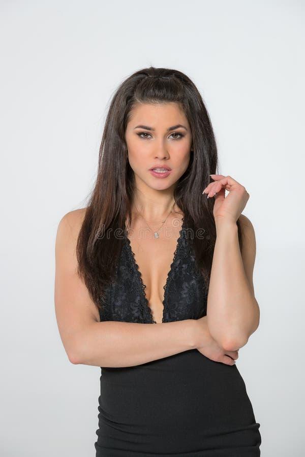 Beautiful Brunette Hispanic Model Posing In A Studio Environment stock images