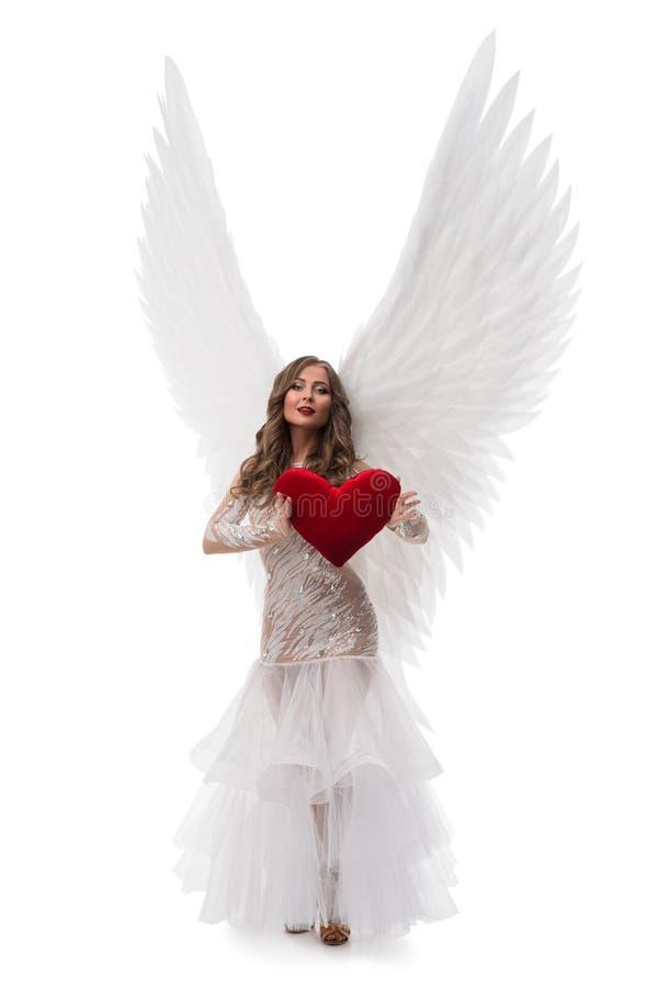 Brunette im herrlichen Kleider- und Flügelschuß stockfoto
