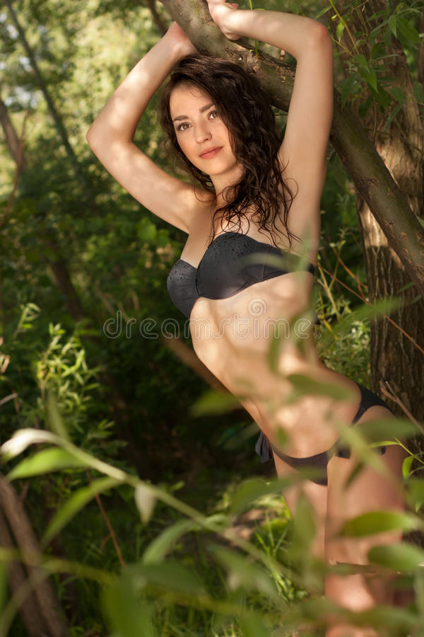 Free Brunette In The Garden Royalty Free Stock Photography - 56153257