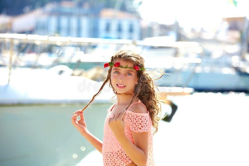 Brunette kid teen girl in Mediterranean port Spain. Brunette kid teen girl in Mediterranean port of Spain royalty free stock image